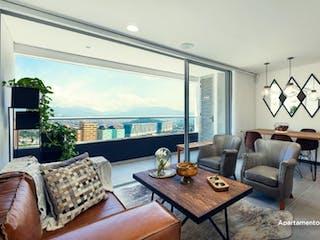 Una sala de estar llena de muebles y una gran ventana en La Rivière