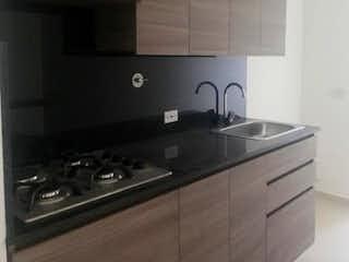 Una cocina con una estufa y un fregadero en URBANIZACÍON SABATTO