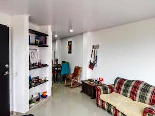 Una sala de estar llena de muebles y una chimenea en termales edificio Juaica P.H. Unidad 201