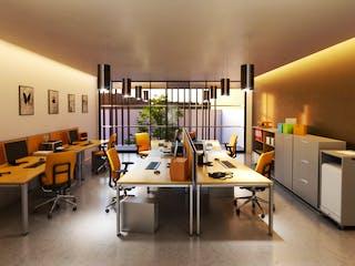 Una habitación que tiene un montón de escritorios en ella en Torre HO