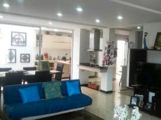 Una sala de estar llena de muebles y una chimenea en Casa en venta en La Granja-Zipaquira de 220 mt2. con 2 niveles.