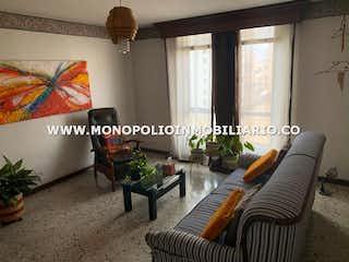 Una sala de estar llena de muebles y una gran ventana en CASABLANCA 1401