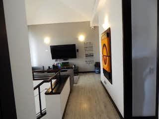 Una vista de una sala de estar y una sala de estar en CONDOMINIO CIGARRAL