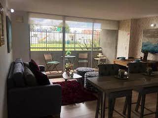 Una sala de estar llena de muebles y una gran ventana en Apartamento en Humedal de Jaboque, Engativa - Tres alcobas