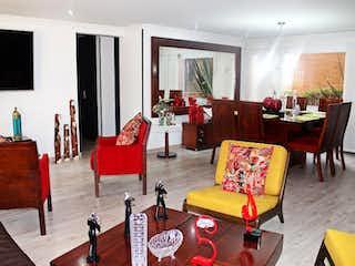 Una sala de estar llena de muebles y una chimenea en Apartamento En Venta En Bogota Niza
