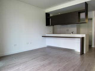 Una bañera blanca sentada en un baño en Apartamento en El Retiro