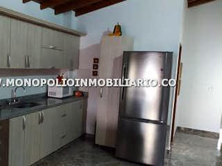 Una cocina con nevera y fregadero en APARTAMENTO EN VENTA - ALCALA ENVIGADO - 3 ALCOBAS