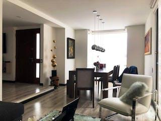 Una sala de estar llena de muebles y una televisión de pantalla plana en Conjunto Del Monte