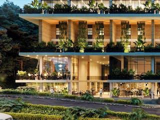 Un gran edificio con un reloj en él en Verticall Living