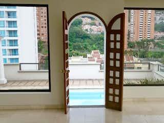 Una vista de un balcón con una gran ventana en Apartamento En Venta En Medellin Las Palmas