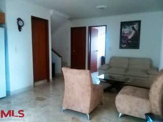 Una sala de estar llena de muebles y una televisión de pantalla plana en Torre Estrella