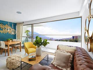 Una sala de estar llena de muebles y una gran ventana en Flor de Loto Apartamentos