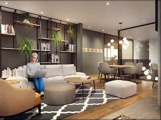 Un grupo de personas sentadas en una sala de estar en Área 93+