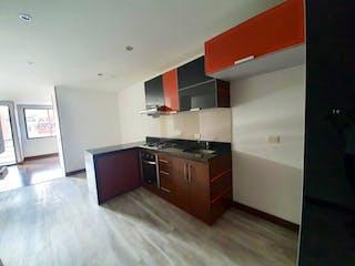 Una cocina con una estufa y un refrigerador en Edificio Skala 142Edificio
