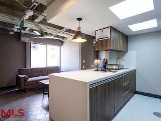 Una cocina que tiene un fregadero y una estufa en ella en Rincones De San Diego