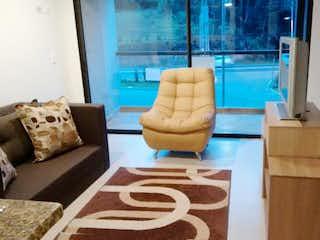 Una sala de estar llena de muebles y una ventana en Apartamento en venta En Rionegro Llanogrande