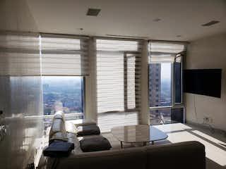 Una sala de estar llena de muebles y una ventana en Departamento en venta en col. Cuauhtémoc, amueblado con amenidades