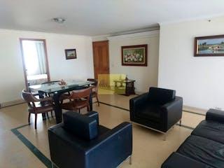 Una sala de estar llena de muebles y una televisión de pantalla plana en UNIDAD MONTE MADERO
