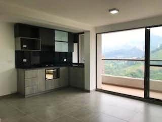 Una cocina con un gran ventanal en ella en Apartamento En Venta En Sabaneta Pan De Azucar