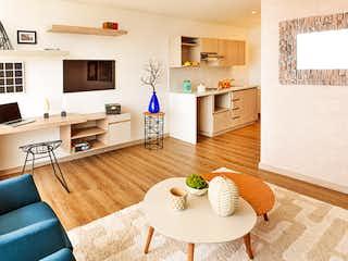 Una sala de estar llena de muebles y una chimenea en Senior's Club El Vergel