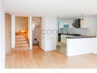 Una cocina con una estufa blanca encima del horno en Penthouse duplex en venta rentandoen El Virrey