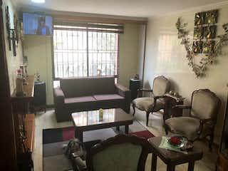 Una sala de estar llena de muebles y una gran ventana en Conjunto Cabrera Vl Casa 6