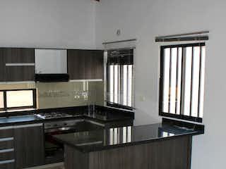 Un cuarto de baño con un lavabo y un inodoro en Apartamento En Venta En Medellin Belen Rosales