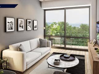 Una sala de estar llena de muebles y una ventana en Departamento en venta en Postal de 71 mt2. con balcón.