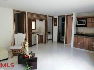 Una sala de estar llena de muebles y una chimenea en Arrecife