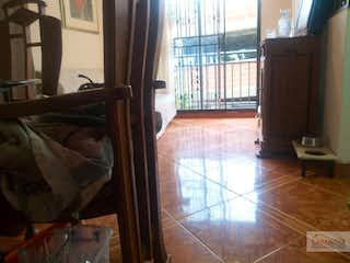 Una cama sentada en una habitación junto a una ventana en Apartamento en Rodeo Alto-Belén, con 3 Habitaciones - 59 mt2.