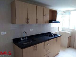 Una cocina con una estufa de fregadero y microondas en Florida de Norte America