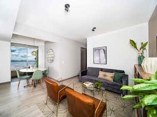 Una sala de estar llena de muebles y una televisión de pantalla plana en Primavera Country Life