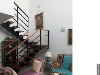 Una sala de estar llena de muebles y decoración en Casa en Llanogrande-Rionegro, con 3 Alcobas - 162 mt2.