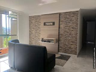Una sala de estar llena de muebles y una chimenea en Apartamento en Bello, Valadares - 61mt, tres alcobas