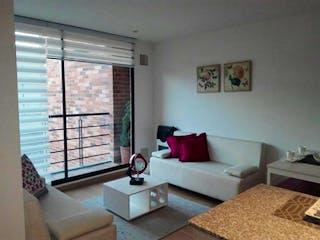 Una sala de estar llena de muebles y una ventana en Palmaluna