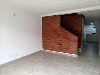 La pared de ladrillo con la ventana en ella en Conjunto Agrupación de vivienda Balmoral norte