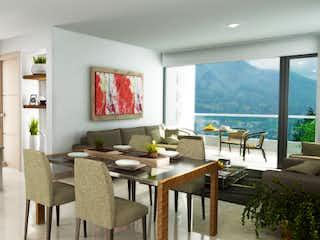 Una sala de estar llena de muebles y una gran ventana en Cattleya