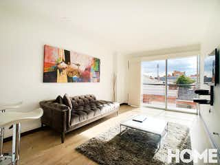 Una sala de estar llena de muebles y una ventana en Apartamento en Santa Barbara Occidental, Santa Barbara - Una alcoba