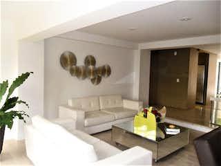 Una sala de estar llena de muebles y una gran ventana en  PIE DE CUESTA