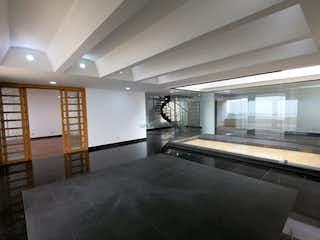 Una habitación con una cama y una mesa en ella en Apartamento en venta en Las Palmas de 400 mts2, Penthouse