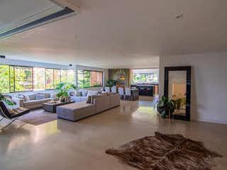 Una sala de estar llena de muebles y una planta en maceta en  VERSALLES