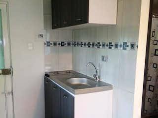 Una cocina con fregadero y nevera en Casa En Venta En Villas de Granada con 103 mt2.