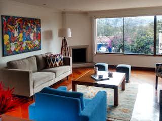 Una sala de estar llena de muebles y una televisión de pantalla plana en Terrazas de Niza