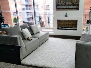 Una sala de estar llena de muebles y una chimenea en Apartamento En Venta En Bogota Sotavento, Con 3 habitaciones-100mt2