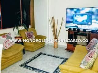 Una sala de estar con un sofá y un televisor en CERROS DEL RODEO 409