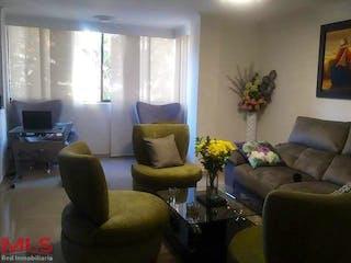 Una sala de estar llena de muebles y una televisión de pantalla plana en Los Rosales