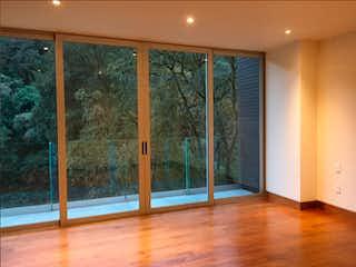 Una vista de una habitación con una puerta de cristal en Cañada