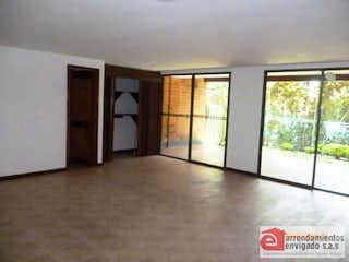 Una vista de una sala de estar con una puerta de cristal en QUEBRADA CLARA