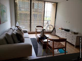 Una sala de estar llena de muebles y una ventana en Apartamento en venta en Canelón de 79 mt2. con balcón