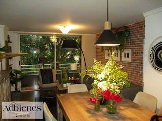 Una sala de estar con un árbol de navidad en ella en Apartamento en venta en Bolivariana, 94mt con balcon
